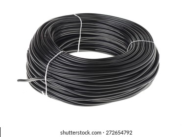 coil of black cable isolated on white