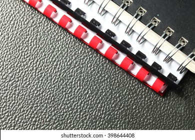 The coil book binding spine on document cover represent the book and paper binding concept related idea.
