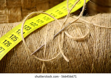 Coil cords with a darning needle and measuring strip