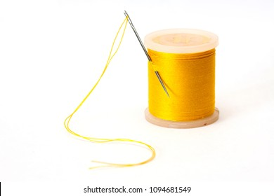 Coil of yellow thread isolated on a white background.