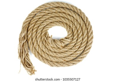 Coiled coarse rope isolated on white background