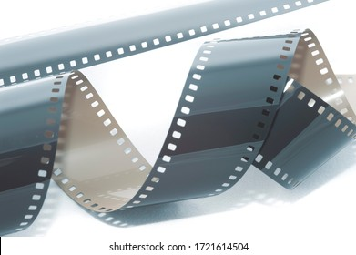Coiled roll of exposed 35 mm film unrolled on a white background in a cinematic or photographic background