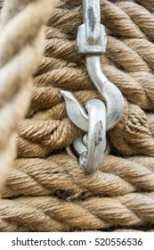 a coiled rope and stell hook