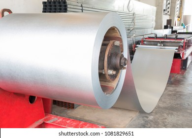 Coiled steel in metal sheet rolling machine ; for tile manufacturing