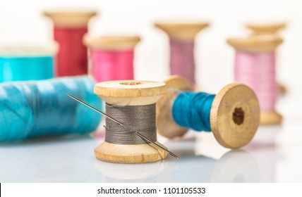 coils with colorful thread on white background