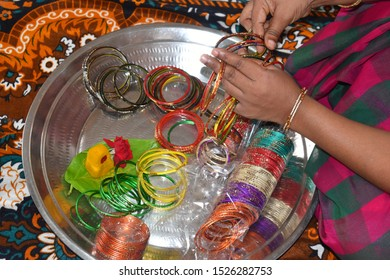 COIMBATORE , INDIA - OCTOBER 09 2019 WOMEN HAND HOLDING BANGLES FOR BRIDE MARRIAGE TAMILNADU