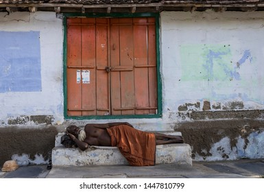 coimbatore, tamil nadu, India-06-16-2019. Sadhu Baba sleeping on the street near the Perur Shiva temple.
