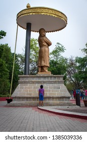 Coimbatore, Tamilnadu, INDIA April 2019.A small Indian boy looking up Swami Vivekananda statue