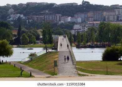 Coimbra, August 17th 2018 : A view of the pedestrian bridge Pedro and Ines crossing the Mondego river