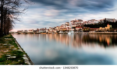 Coimbra, known as a city known for its historical univessity, is crossed by the river Mondego. The photo shows us the university tower, the river and Santa Clara bridge.