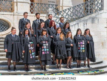 Coimbra, Portugal - April 2018: a group of graduates in the university yard