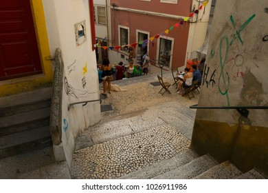COIMBRA, PORTUGAL - August 13, 2016: Tourists explore the ancient lanes of the historic university city of Coimbra, Portugal. Pictured here the stairs above Quebra Costas.