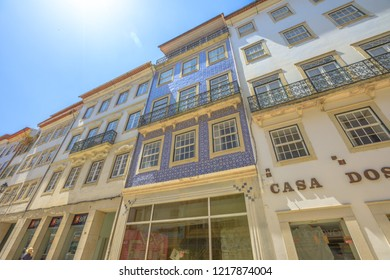Coimbra, Portugal - August 14, 2017: windows architecture of historic buildings in Rua Ferreira Borges in center of Lower Coimbra, the medieval part of Portuguese city. Urban street background.