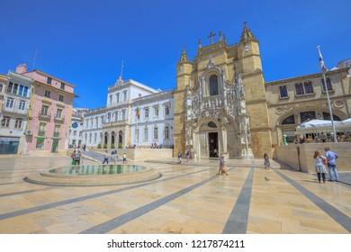 Coimbra, Portugal - August 14, 2017: Praca Oito de Maio or Terreiro de Santa Cruz with fountain, Santa Cruz Monastery and Town Hall. Lower Coimbra, the medieval part of the city.