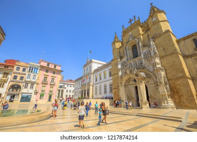 Coimbra, Portugal - August 14, 2017: people in Praca Oito de Maio or Terreiro de Santa Cruz with main facade of Santa Cruz Monastery and Town Hall. Lower Coimbra, the medieval part of the city.