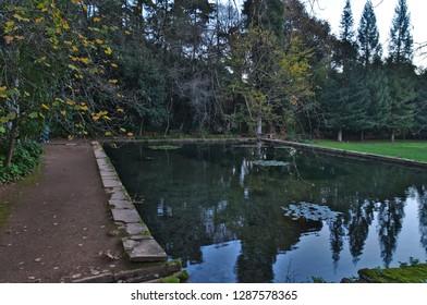 Coimbra, Coimbra / Portugal - December 31 2018: Pond in Quinta das Lagrimas Garden