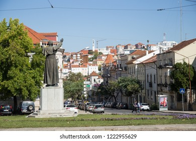 Coimbra, Portugal - October 10, 2018: Statue of Pope John Paul II in Coimbra and the view of the beautiful architecture near Coimbra University