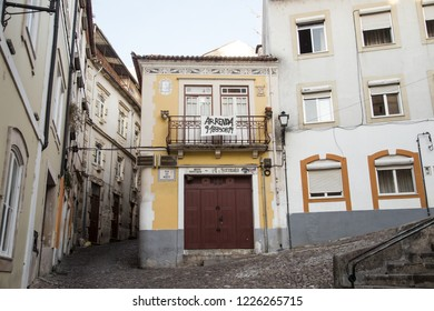 Coimbra, Portugal - October 10, 2018: The narrow street going up to Coimbra university campus and surrounding old buildings