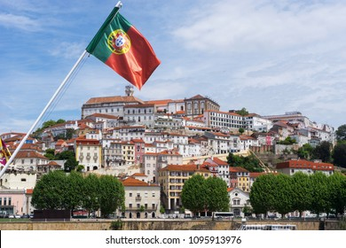 Coimbra, Portugal, Old City View with Portugese national flag swinging under blue sky