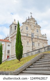 Coimbra, Portugal - Sep 4th 2018: Beautiful baroque facade of New Cathedral, known also as Se Nova Cathedral in portuguese Coimbra. Originally it was the church of Jesuits established in 16th century.