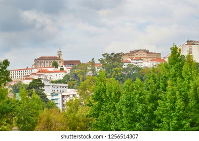 Coimbra, Portugal - Sep 4th 2018: Coimbra skyline with the university bell tower on a cloudy summer day. Coimbra is a beautiful historic city with many beautiful sights.