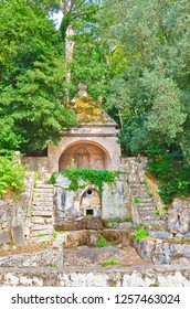 Coimbra, Portugal - Sep 4th 2018: Stone staircase with an old well in the Botanical Garden of the University of Coimbra. The garden was founded in the 18th century. It is a popular tourist spot.