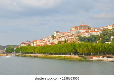 Coimbra, Portugal - Sep 4th 2018: Beautiful cityscape of Coimbra located along the Mondego River. The most remarkable spot is famous University of Coimbra with dominant bell tower.
