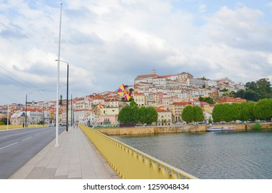 Coimbra, Portugal - Sep 4th 2018: View of Santa Clara Bridge over the Mondego River with the old town on the hill in the background. Coimbra is a beautiful historic city with many tourist spots.