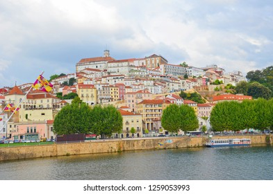 Coimbra, Portugal - Sep 4th 2018: Awesome view of Coimbra old town taken from the Santa Clara Bridge over the Mondego River. The dominant of the city are buildings of famous University of Coimbra.