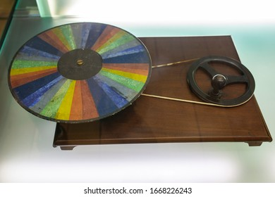 Coimbra, Portugal - Sept 6th 2019: 1858 Vintage Newton disc. History of science concept. Science Museum of the University of Coimbra, Portugal