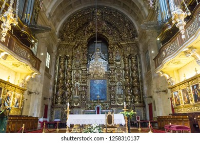 Coimbra, Portugal - September 14, 2018:  Interior of the Old Cathedral of Coimbra, (Se Velha de Coimbra), magnificent gilt wood altarpiece - Image