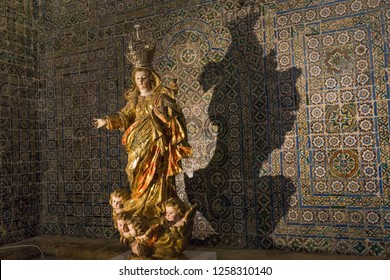 Coimbra, Portugal - September 14, 2018:  Interior of the Old Cathedral of Coimbra, (Se Velha de Coimbra), magnificent golden figurine.- Image