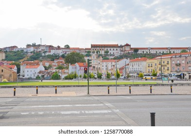 Coimbra, Portugal - September 4th 2018: Crossing the road on a red light in the city center nearby the Mondego River. Coimbra is a beautiful historical city with many remarkable sights.