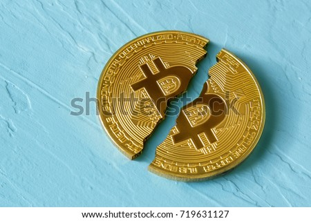 Coin bitcoin is broken in half. The fall and collapse of the course of the crypto currency, the ban on trade