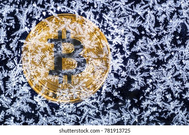 Coin bitcoin is covered with ice. Freeze bitcoin. To ban bitcoin.