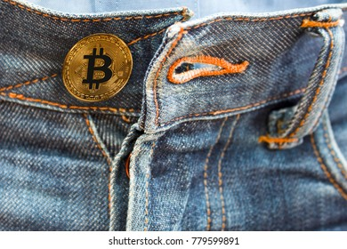 coin bitcoin instead of buttons on jeans. new fashion. sex for bitcoins.