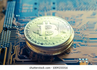 Coin Bitcoin on the electronic Board. Mining cryptocurrency. The concept of technologies blockchain of virtual currencies