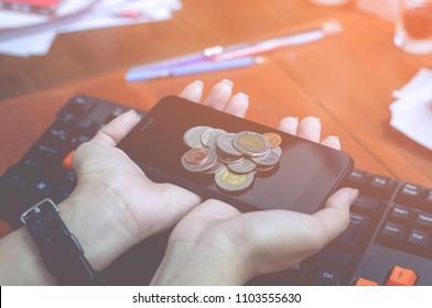 coin cellphone hand keyboard Blue light Green light Orange light