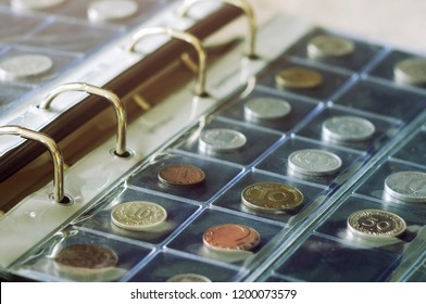 Coin collecting. Close-up view of coins holding in blisters in coin album. Numismatics