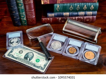 Coin collection with on table with literature.