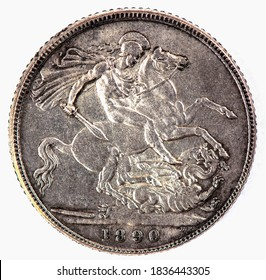 A coin commemorating featuring a portrait of St. George on horseback slaying the dragon. Colorful History of England, 1890.