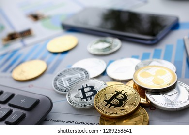 Coin crypto currency bitcoin lies on calculator keyboard background theme silver exchange pyramid for money due to rise or fall exchange rate closeup
