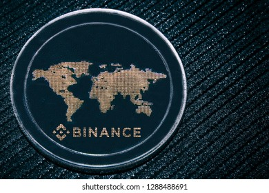 Coin cryptocurrency BNB on a grey shiny background. Binance.