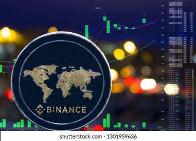 Coin cryptocurrency BNB on night city background and chart. Binance