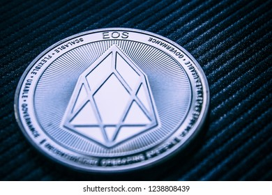 The coin cryptocurrency EOS on dark background.