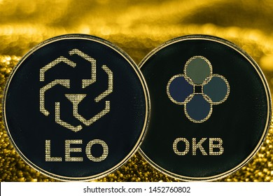 Coin cryptocurrency Leo OKB okexand gold fabric background. bifinex token logo.