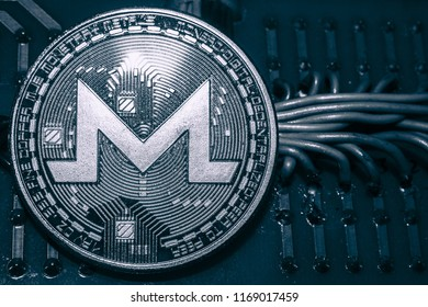 The coin cryptocurrency Monero on the background of wires and circuits. XMR