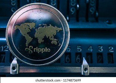 Coin cryptocurrency ripple on the background of numbers of the arithmometer. The concept of production or rate of xrp.