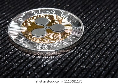 The coin cryptocurrency ripple on black background.