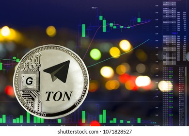 Coin cryptocurrency telegram on night city background and chart.